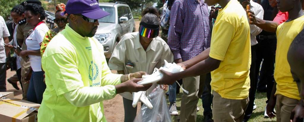 Kanye West Gave Away Free Yeezys to Kids in Uganda then Danced With Them